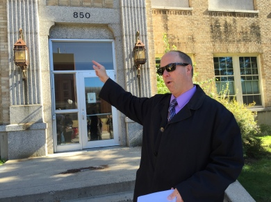 Thomas Steman, University Archivist and Professor, in front of Eastman Hall, now closed to the pubic. Photo by Jannet Walsh